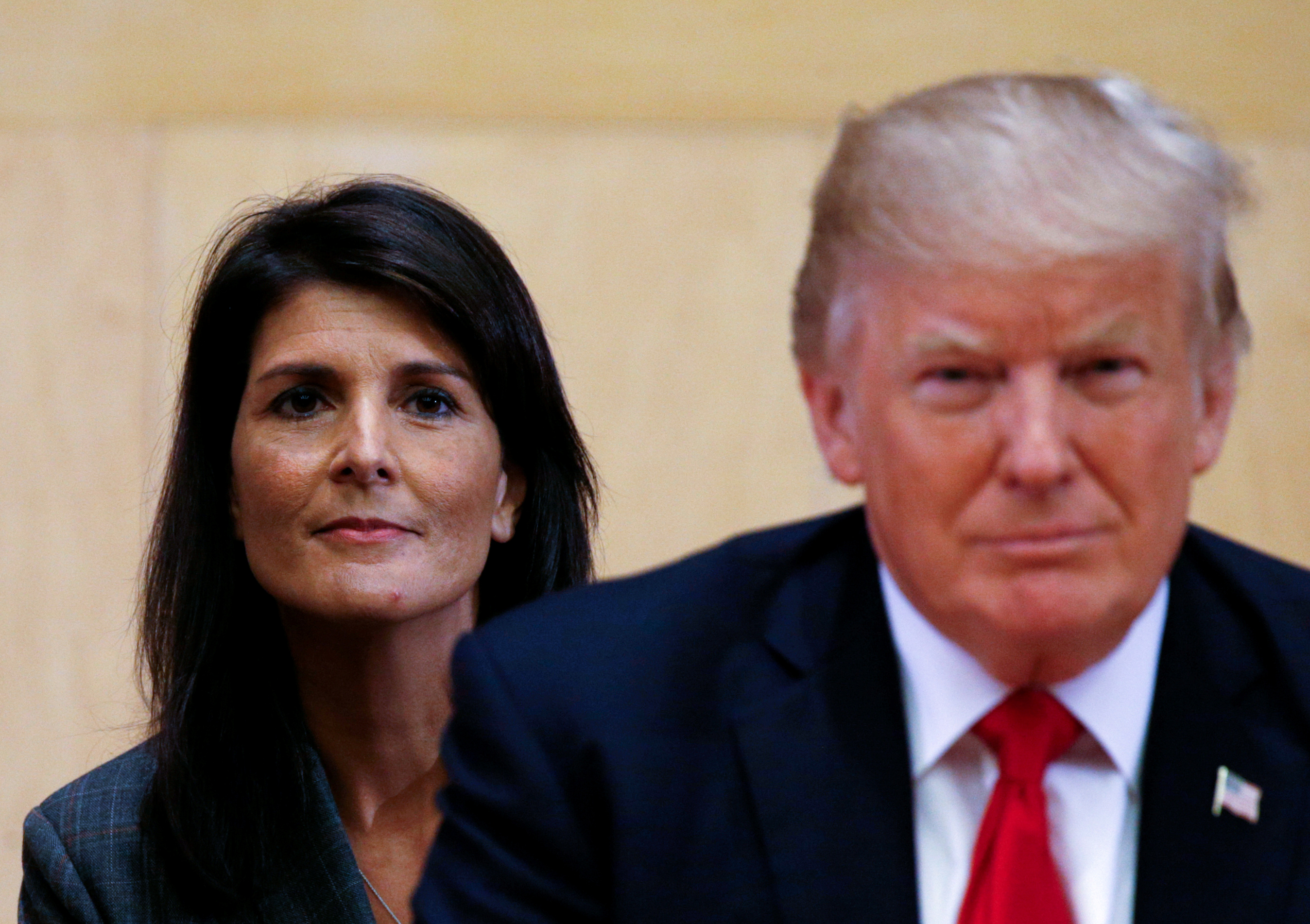 FILE PHOTO: U.S. Ambassador to the UN Nikki Haley (L) and U.S. President Donald Trump participate in a session on reforming the United Nations at UN Headquarters in New York, U.S., Sept.18, 2017. REUTERS/Kevin Lamarque/File Photo
