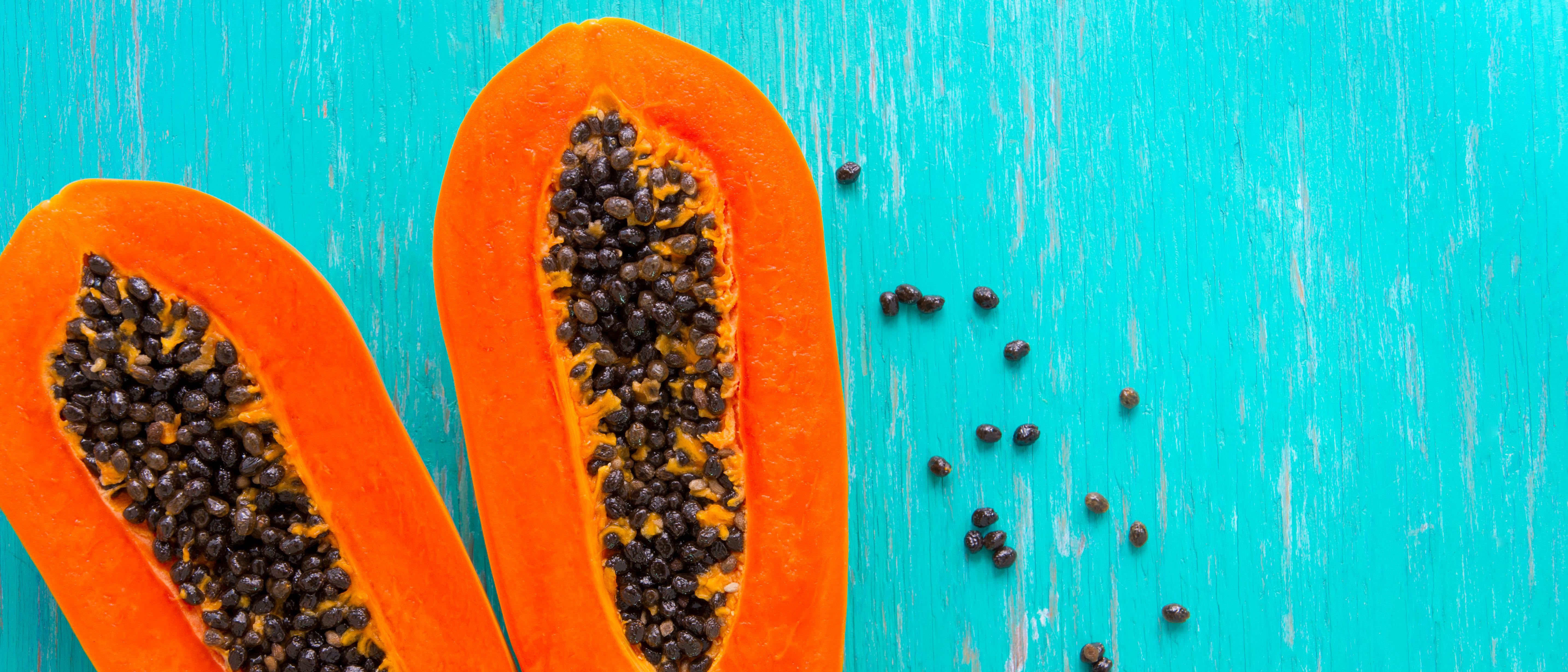 Papaya fruit on wooden background. (Shutterstock/Seksun Guntanid)