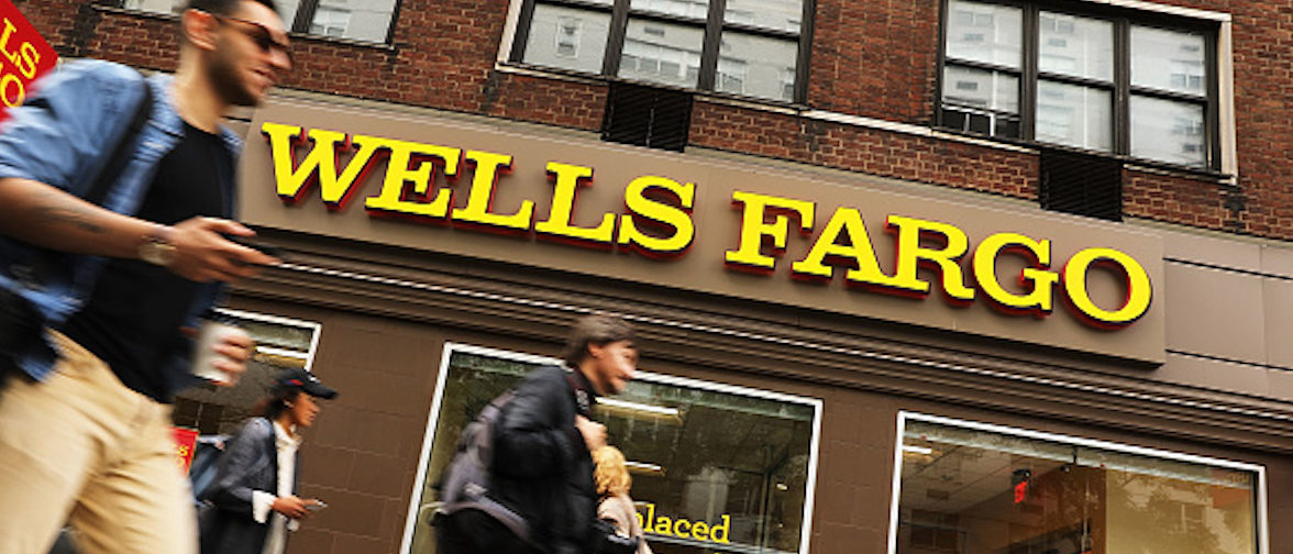 NEW YORK, NY - OCTOBER 13:  People walk by a Wells Fargo bank branch on October 13, 2017 in New York City. Wells Fargo shares were down 3.4% to$53.34in afternoontrading following news that the banks quarterly profit from July through September dropped nearly 19%.  (Photo by Spencer Platt/Getty Images)