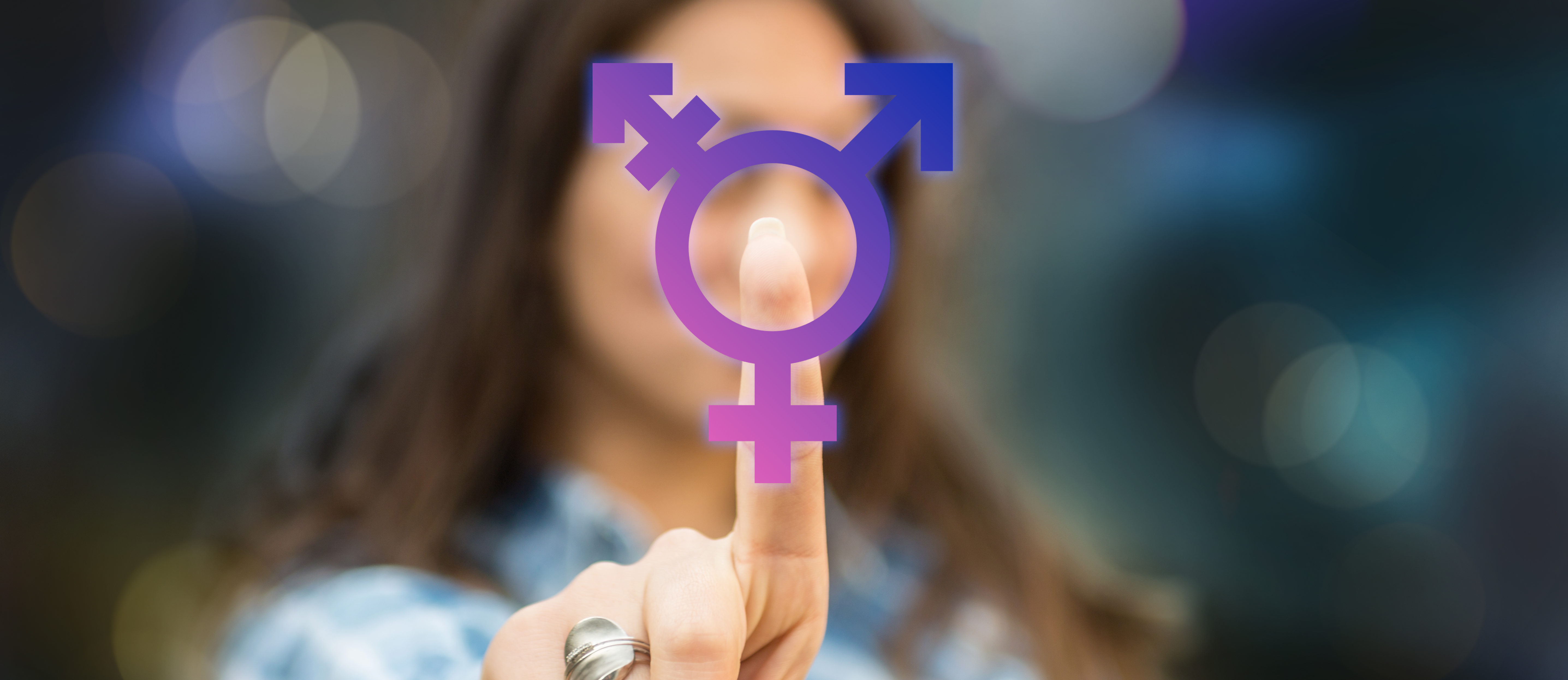 Person pressing transgender symbol on touch screen. (Shutterstock/FotoCuisinette)
