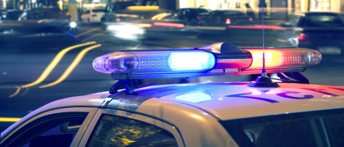 Police Car Lights (ShutterStock/Tiko Aramyan)