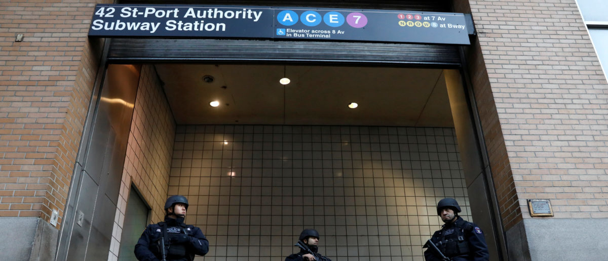 Police officers stand guard outside the closed New York Port Authority Subway entrance following an reported explosion, in New York City, U.S. December 11, 2017. (Photo: REUTERS/Brendan McDermid)