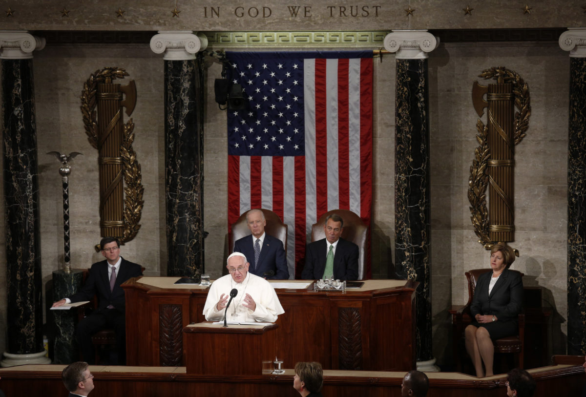 Pope Francis addresses a joint meeting of the U.S. Congress as Vice President Joe Biden (L) and Speaker of the House John Boehner (R) look on in the House of Representatives Chamber on Capitol Hill in Washington September 24, 2015. REUTERS/Kevin Lamarque
