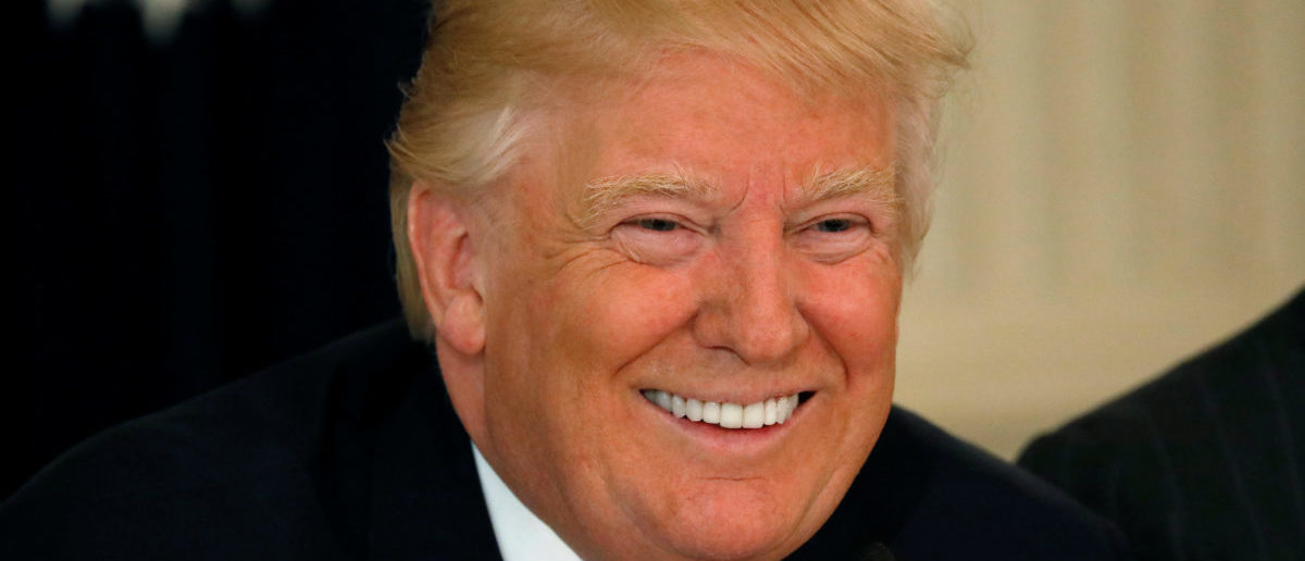 U.S. President Donald Trump smiles during a meeting with manufacturing CEOs at the White House in Washington, DC, U.S. February 23, 2017. REUTERS/Kevin Lamarque