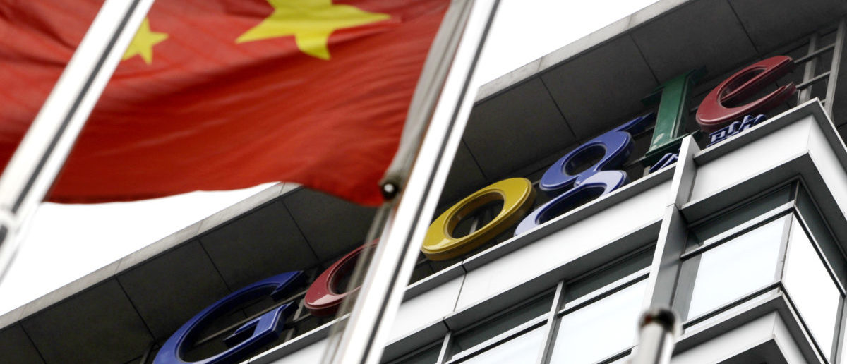 The national flag of China flies in front of the former headquarters of Google in Beijing, July 1, 2010. China's foreign ministry said on Thursday that it had no comment on Google's decision to end automatic rerouting of Chinese users to its uncensored Hong Kong search portal, in a bid to keep its China operating license. REUTERS/Jason Lee