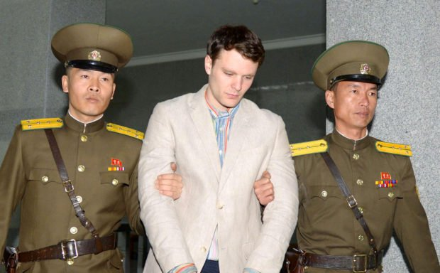 Otto Frederick Warmbier (C), a University of Virginia student who was detained in North Korea since early January, is taken to North Korea's top court in Pyongyang, North Korea, in this photo released by Kyodo March 16, 2016. Mandatory credit REUTERS/Kyodo/File Photo