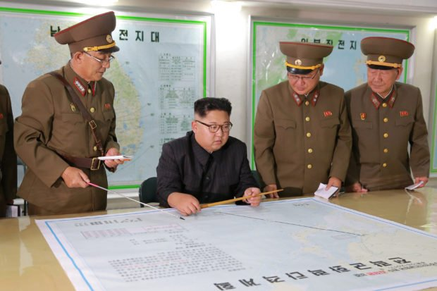 North Korean leader Kim Jong Un visits the Command of the Strategic Force of the Korean People's Army (KPA) in an unknown location in North Korea in this undated photo released by North Korea's Korean Central News Agency (KCNA) on August 15, 2017. KCNA/via REUTERS