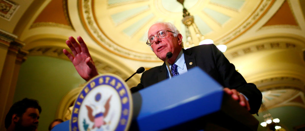 Senator Bernie Sanders (I-VT) speaks to reporters following a policy luncheon on Capitol Hill in Washington, U.S. October 17, 2017. REUTERS/Eric Thayer