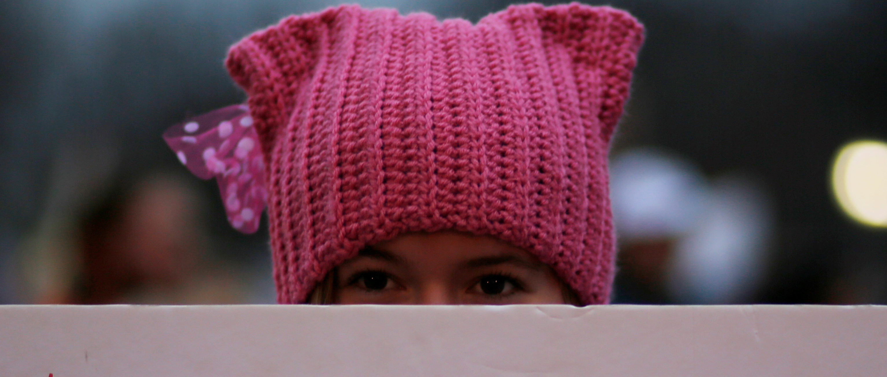 A woman wearing pink pussy protest hat poses for a photograph during the Women's March on Washington, following the inauguration of U.S. President Donald Trump, in Washington, DC, U.S. January 21, 2017. REUTERS/Brian Snyder