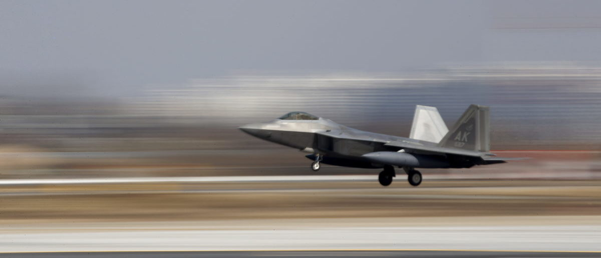 A U.S. F-22 stealth fighter jet lands at Osan Air Base in Pyeongtaek, South Korea, February 17, 2016.  REUTERS/Kim Hong-Ji