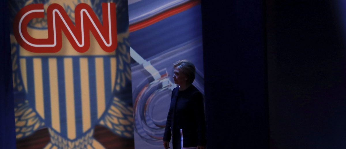 Democratic U.S. Presidential candidate Hillary Clinton returns to the stage after a break during a town hall meeting hosted by CNN in Columbus, Ohio March 13, 2016. REUTERS/Carlos Barria - GF10000344431