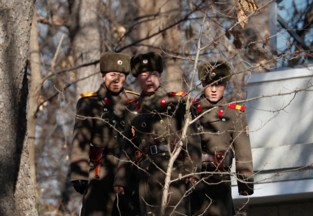 A North Korean soldier keeps watch toward the south in front of their guard post just next to a spot where a North Korean has defected crossing the border on November 13, at the truce village of Panmunjom inside the demilitarized zone, South Korea, November 27, 2017. REUTERS/Kim Hong-Ji