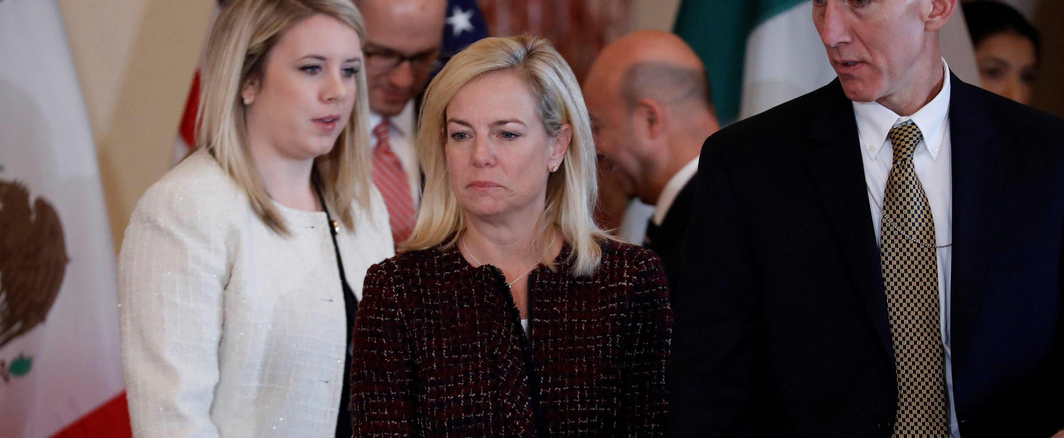 Department of Homeland Security Secretary Kirstjen Nielsen looks for her seat prior to a meeting to discuss strategies to disrupt transnational criminal organisations at the State Department in Washington, U.S., December 14, 2017. REUTERS/Aaron P. Bernstein