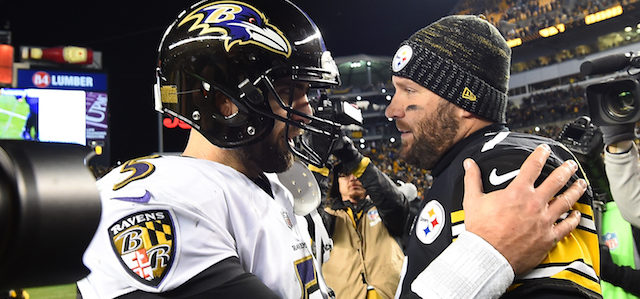 PITTSBURGH, PA - DECEMBER 10: Ben Roethlisberger #7 of the Pittsburgh Steelers meets Joe Flacco #5 of the Baltimore Ravens at mid field after the conclusion of the Pittsburgh Steelers 39-38 win over the Baltimore Ravens at Heinz Field on December 10, 2017 in Pittsburgh, Pennsylvania. (Photo by Joe Sargent/Getty Images)