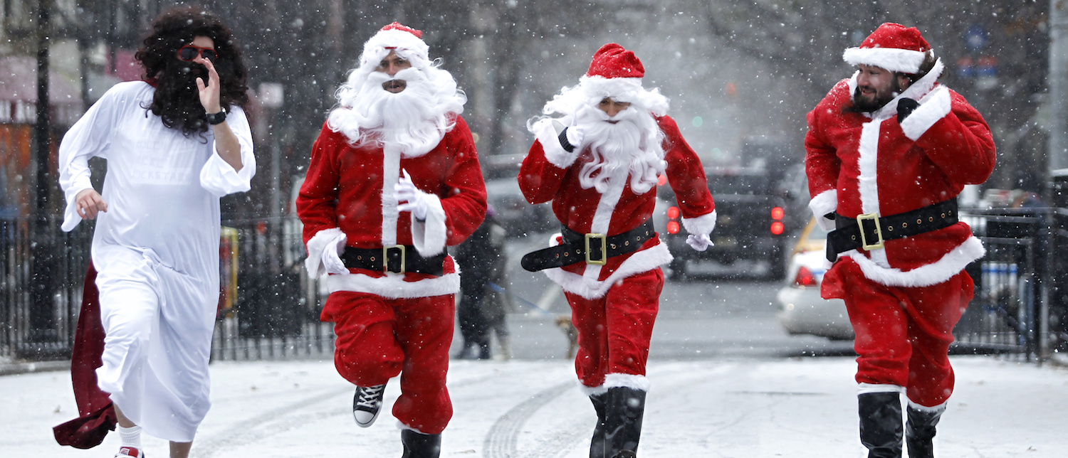 Revelers dressed as Santa Claus run as the arrive at Tompkins Square Park to take part during the annual SantaCon bar crawl event on December 14, 2013 in New York City (Photo: Kena Betancur/Getty Images)