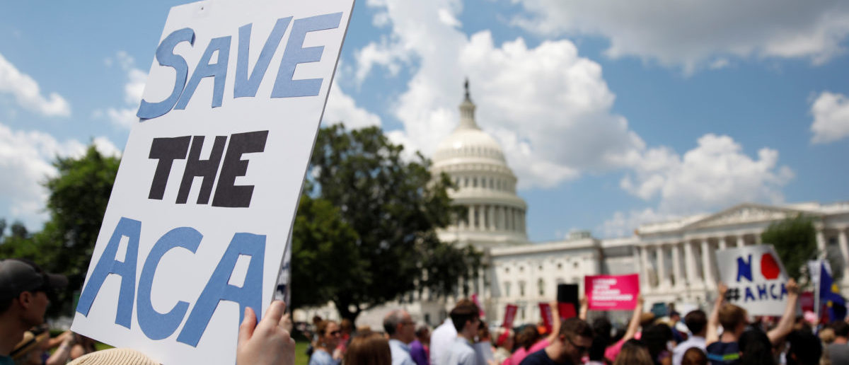 Protestors gather during a demonstration against the Republican repeal of the Affordable Care Act, outside the U.S. Capitol in Washington, U.S., June 21, 2017. REUTERS/Aaron P. Bernstein