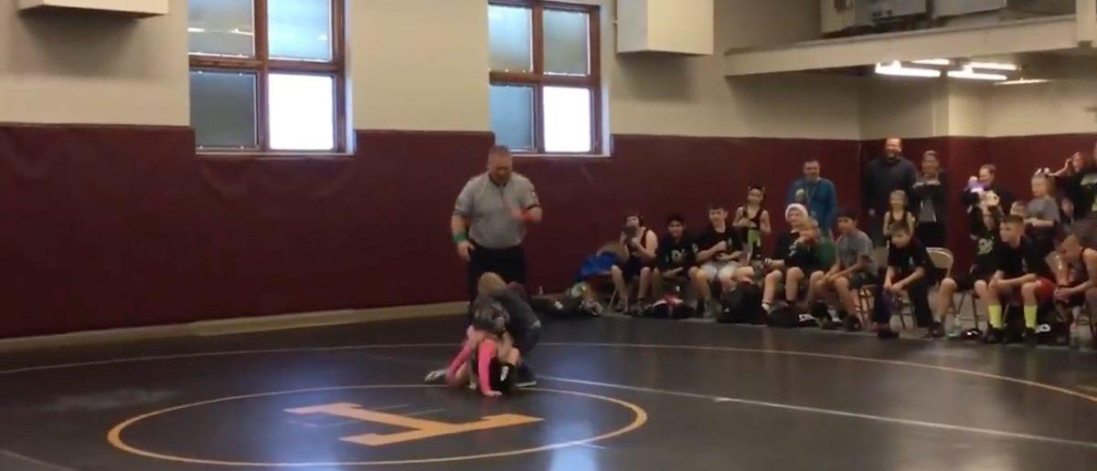 Wrestling (Credit: Screenshot/Facebook Video WFLA News)