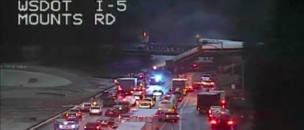 Train derailed over I5 near Olympia, Washington. (Photo: WSDOT)