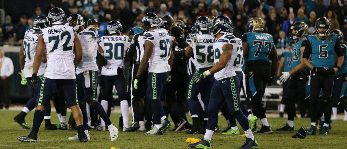 JACKSONVILLE, FL - DECEMBER 10: Members of the Seattle Seahawks and the Jacksonville Jaguars tussle on the field during the second half of their game at EverBank Field on December 10, 2017 in Jacksonville, Florida. (Photo by Logan Bowles/Getty Images)