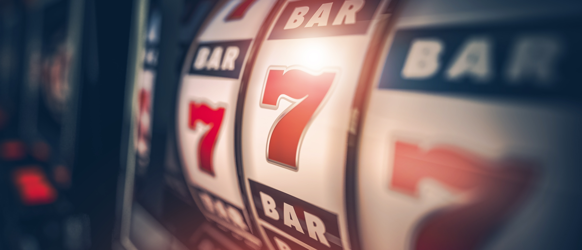 Casino Slot Games Playing Concept 3D Illustration. One Armed Bandit Slot Machine Closeup. (Shutterstock/welcomia)