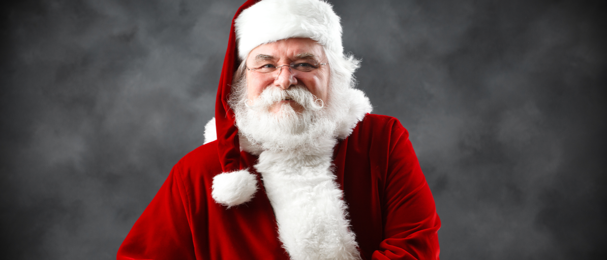 Santa Claus is looking into the camera with his hands crossed in front of him. (Photo: Shutterstock/ Aldo Risolvo)