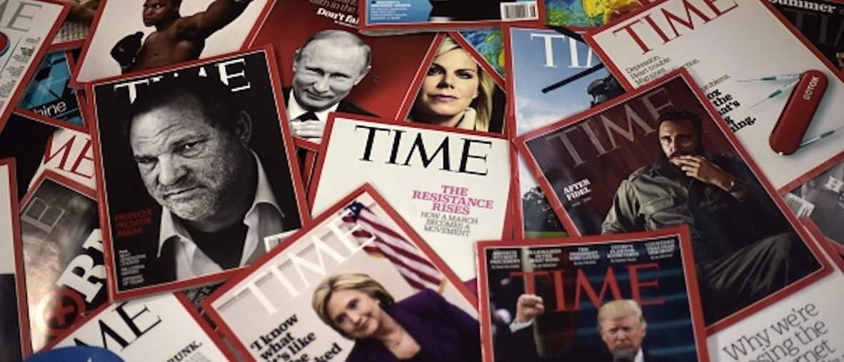Time magazine copies are dispalyed on a table in Washgington on November 27, 2017. Time Inc. is selling for $2.8 billion to media conglomerate Meredith Corporation, which is backed by the billionaire Koch brothers, who are known for supporting conservative causes. Time, which also publishes its eponymous magazine, Fortune, and Sports Illustrated, began looking for a buyer late last year before giving up several months later, while welcoming options. / AFP PHOTO / Eric BARADAT (Photo credit should read ERIC BARADAT/AFP/Getty Images)