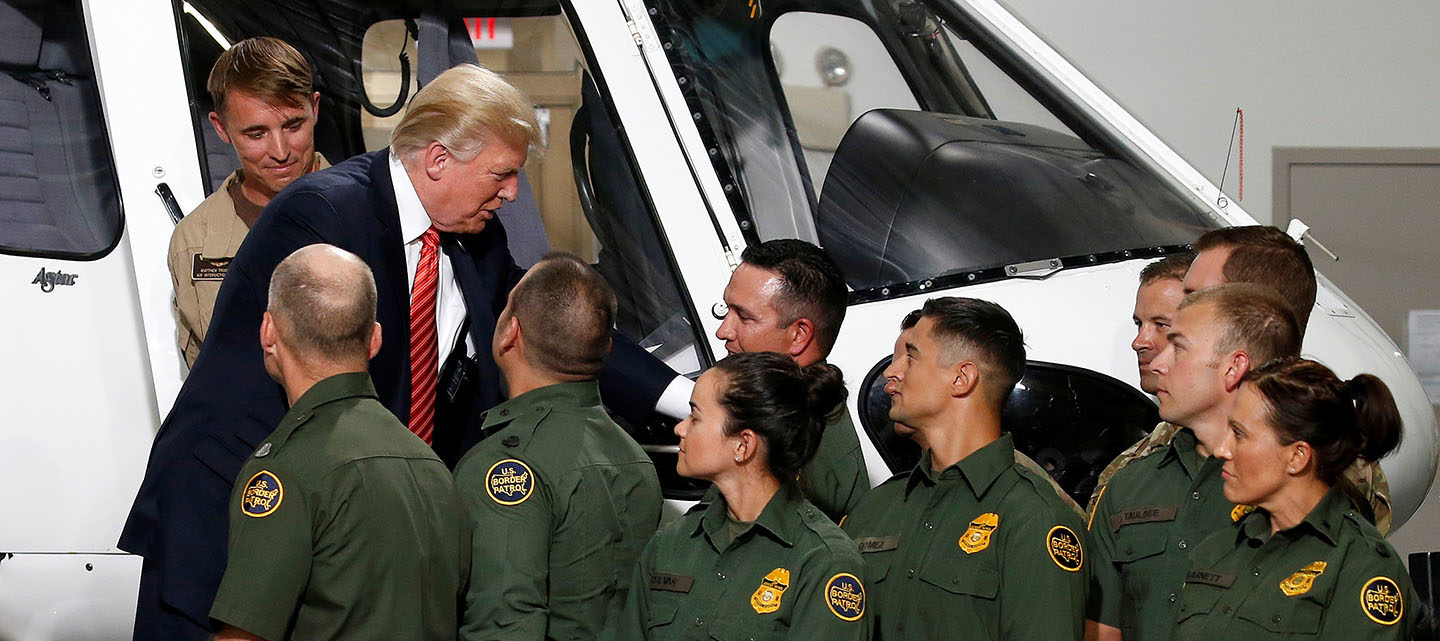 U.S. President Donald Trump greets Border Patrol agents as he tours the U.S. Customs and Border Patrol facility in Yuma, Arizona, U.S., August 22, 2017.   REUTERS/Joshua Roberts