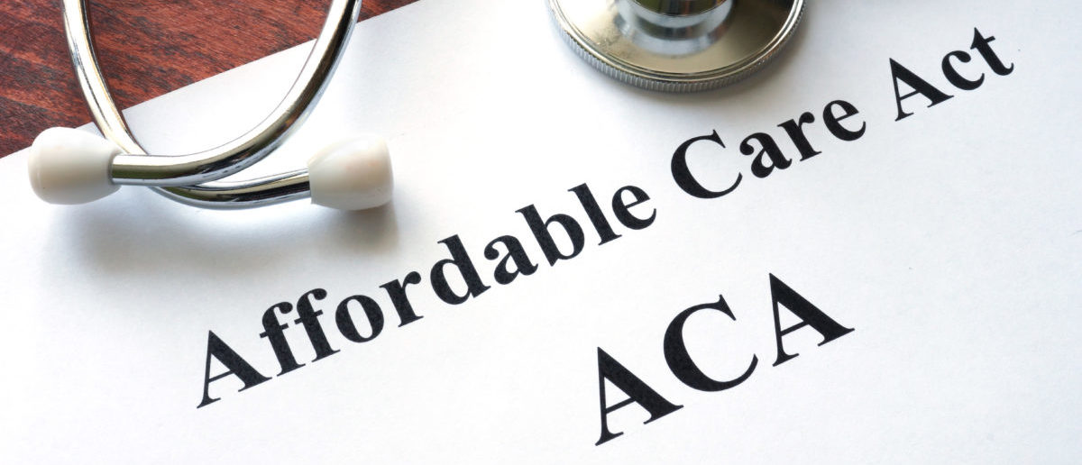 Words Affordable Care Act are written on a paper. (Photo: ShutterStock/Designer491)