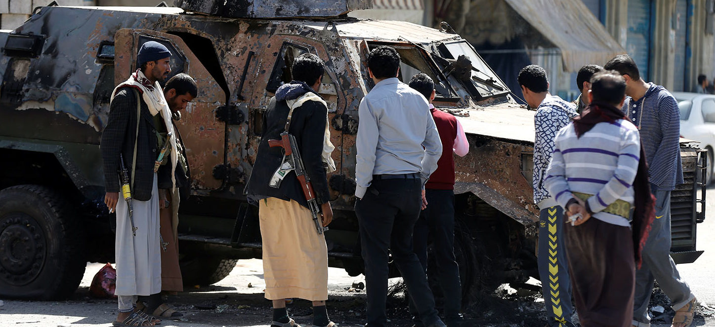 Houthi fighters and people look at an armored personnel carrier damaged by recent clashes with forces loyal to Yemen's former president Ali Abdullah Saleh in Sanaa, Yemen December 5, 2017. REUTERS/Khaled Abdullah