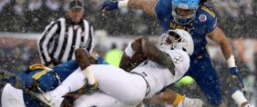 Ahmad Bradshaw #17 of the Army Black Knights is tackled by Micah Thomas #44 of the Navy Midshipmen on December 9, 2017 at Lincoln Financial Field in Philadelphia, Pennsylvania. Elsa/Getty Images.