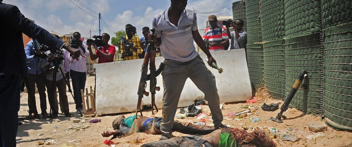 Weapons are gathered from two dead militants suspected of being members of the al-Shabab, in Mogadishu on April 16, 2017. Somali security forces shot dead two suspected al-shabab militants, an Al-Qaeda linked extremist group, who were said to be involved in firing rockets.  Mohamed Abdiwahab/AFP/Getty Images.