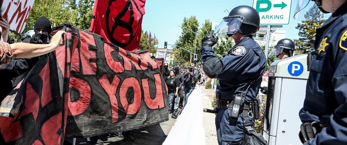 Riot police stand before Antifa members and counter protesters during a rightwing No To Marxism rally on August 27, 2017 at Martin Luther King Jr. Park in Berkeley, California. (Photo: Amy Osborne/AFP/Getty Images)
