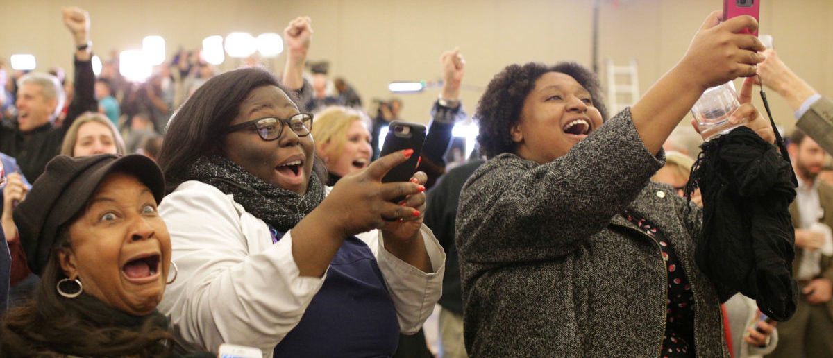 Supporters of Democratic Alabama U.S. Senate candidate Doug Jones celebrate at the election night party in Birmingham, Alabama, U.S., December 12, 2017. Picture taken December 12, 2017. REUTERS/Marvin Gentry