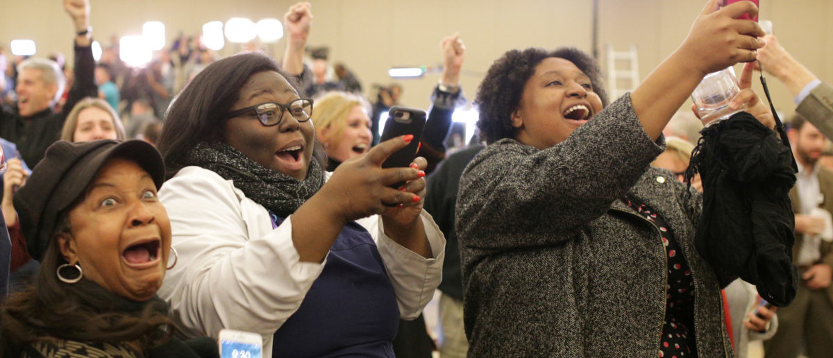 Supporters of Democratic Alabama U.S. Senate candidate Doug Jones celebrate at the election night party in Birmingham, Alabama, U.S., December 12, 2017. Picture taken December 12, 2017. REUTERS/Marvin Gentry -