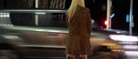 A prostitute from Eastern Europe waits for customers along the Promenade des Anglais in Nice, November 29, 2013. French lawmakers will start debating today a bill aimed at stemming prostitution with steep fines to clients - a radical switch from the country's traditionally tolerant stance that will give it some of the toughest legislation in Europe. Prostitution is not illegal in France, which has an estimated 18,000 to 20,000 sex workers according to a 2012 report by the Scelles Foundation, but there are laws against pimping, human trafficking and soliciting sex in public. REUTERS/Eric Gaillard