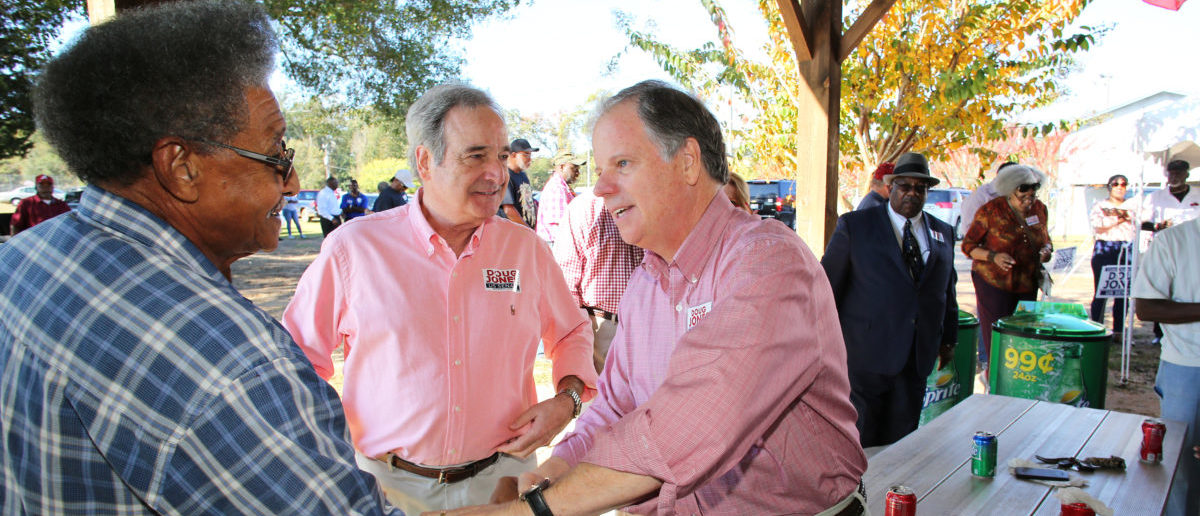 Democratic Alabama U.S. Senate candidate Doug Jones (R), greets supporters while campaigning at an outdoor festival in Grove Hill, Alabama, U.S. on November 4, 2017. Picture taken on November 4, 2017.   REUTERS/Mike Kittrell