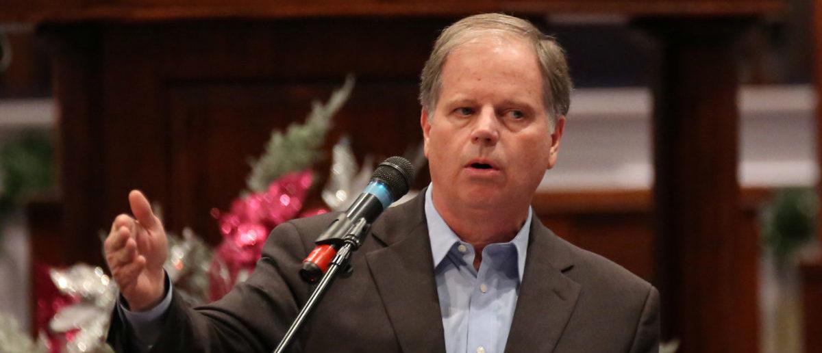 Democratic Alabama U.S. Senate candidate Doug Jones speaks to the Progressive Union Missionary Baptist Church in Huntsville, Alabama, U.S. December 10, 2017. REUTERS/Marvin Gentry