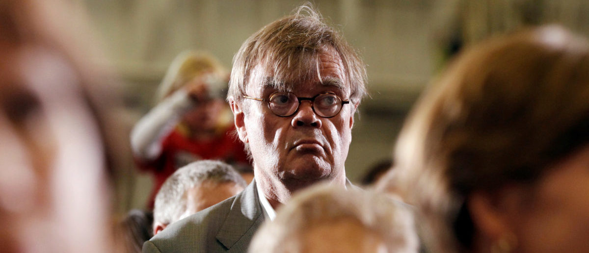 FILE PHOTO: Author and radio personality Garrison Keillor listens to U.S. President Barack Obama speak at a campaign rally in Minneapolis, Minnesota, U.S. October 23, 2010. REUTERS/Kevin Lamarque
