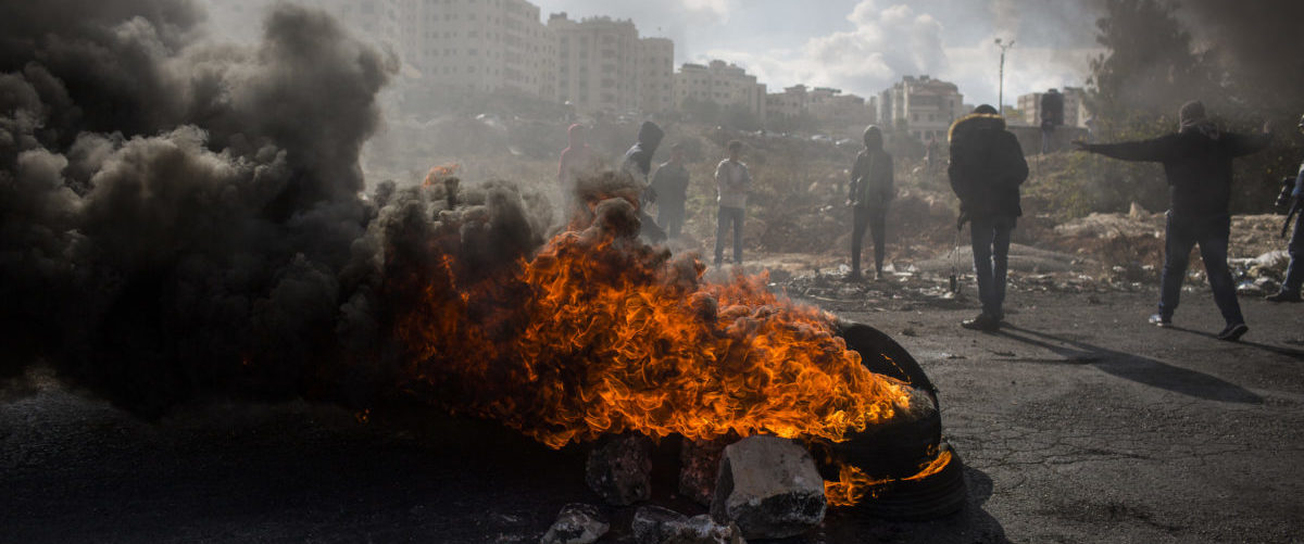 Palestinians take part in clashes with IDF on December 15, 2017 in Jerusalem, Israel. Today is the tenth day of clashes in the West Bank, Jerusalem and Gaza following Donald Trump's speech. Ilia Yefimovich/Getty Images.