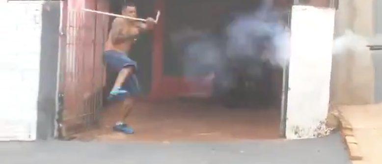 Brazilian man is shot by bean bag (Screenshot / LiveLeak)