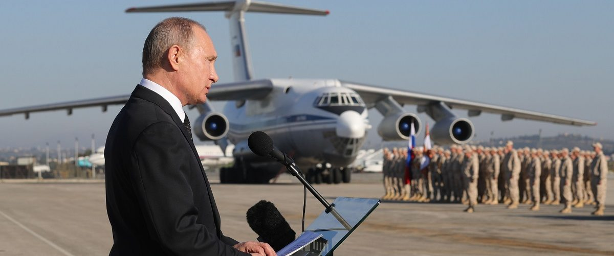 Russian President Vladimir Putin delivers a speech as he inspects a parade during his visit to the Russian air base in Hmeimim in the northwestern Syrian province of Latakia on December 11, 2017. Russian news agencies reported that Putin gave an order for partial withdrawal of Russian troops from Syria during his press conference on December 11. Mikhail Klimentyev/AFP/Getty Images.