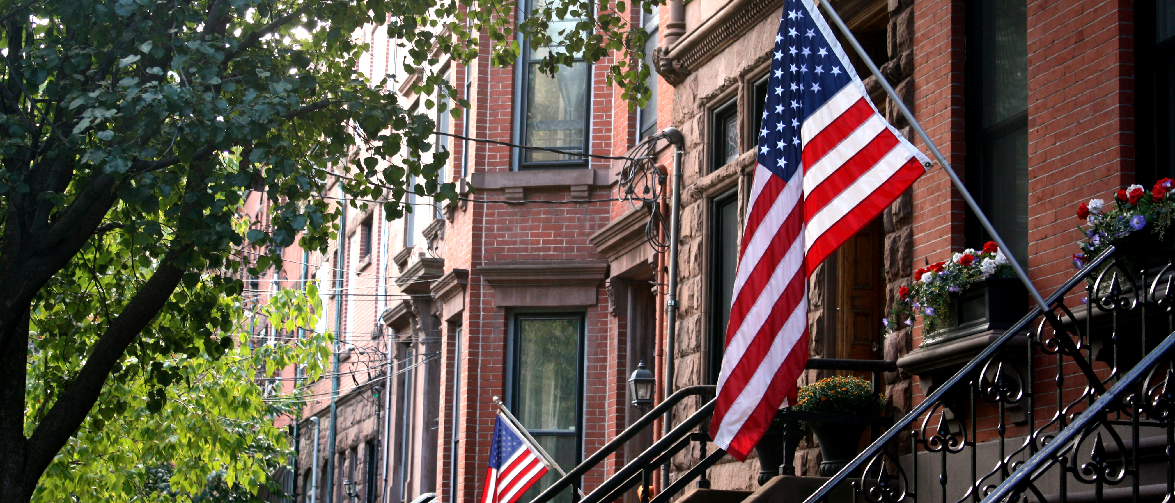 Patriotic row of homes shutterstock