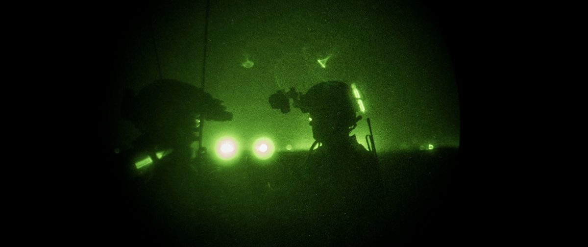 Members of the United States Army Special Forces Operational Detachment Alpha through a night vision goggle during casevac night training of Afghanistan Special Forces on September 10, 2017 at Camp Shorab in Helmand Province, Afghanistan. (Photo: Andrew Renneisen/Getty Images)