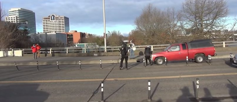 The moment before an Antifa protestor is hit by a truck (Ruptly / Youtube / Screenshot)