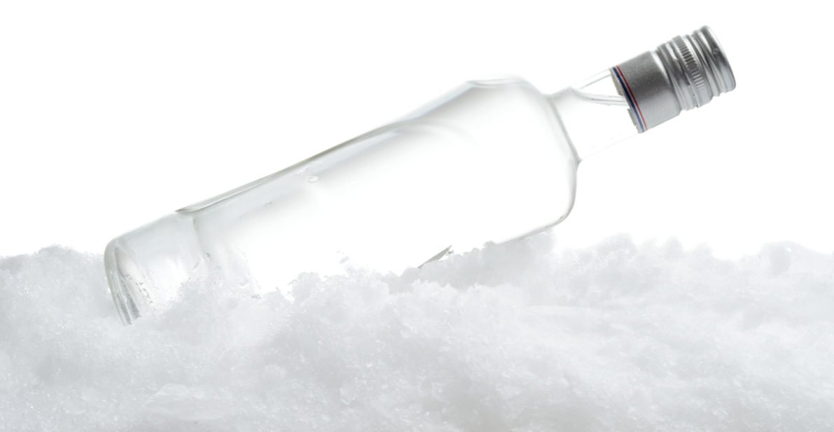 Here is a close-up view of bottle of vodka lying on ice. (Photo: Shutterstock/ Tadeusz Wejkszo)