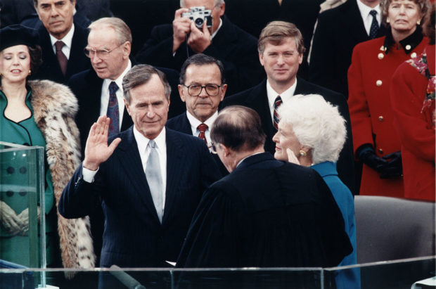 Chief Justice William Rehnquist administering the oath of office to President George H. W. Bush during Inaugural ceremonies at the United States Capitol via Wikimedia Commons