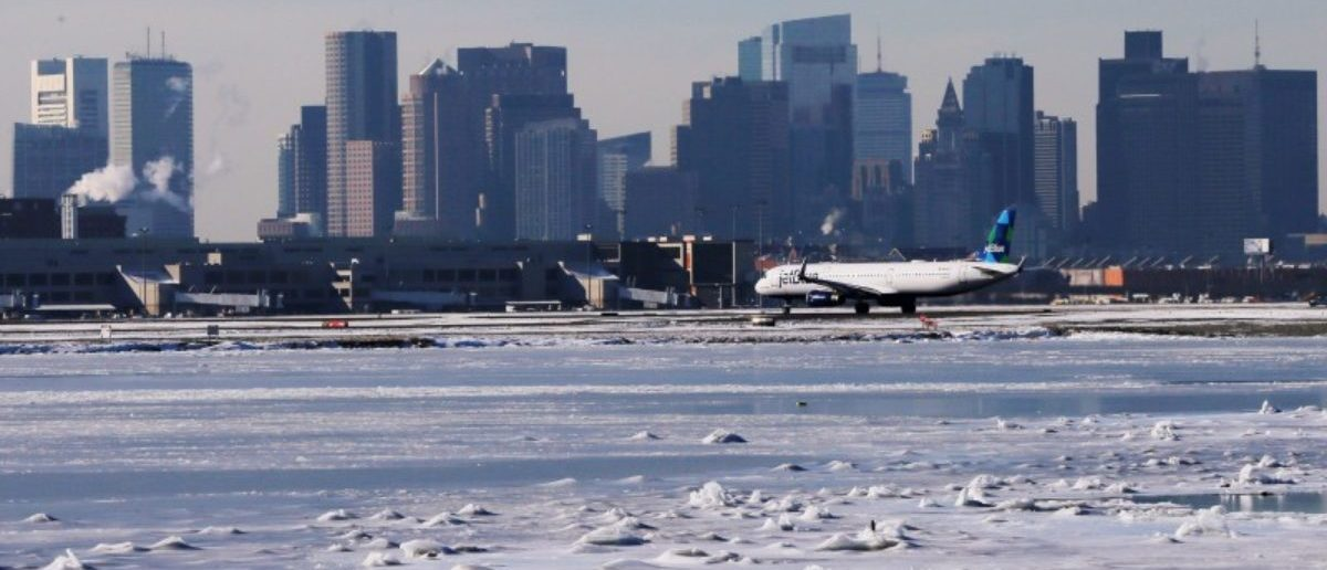 FILE PHOTO: Ahead of an incoming winter snow storm, a Jet Blue flight waits to take off from Logan International Airport next to the frozen waters of the Atlantic Ocean harbour between Winthrop and Boston, Massachusetts, U.S., January 3, 2018. REUTERS/Brian Snyder