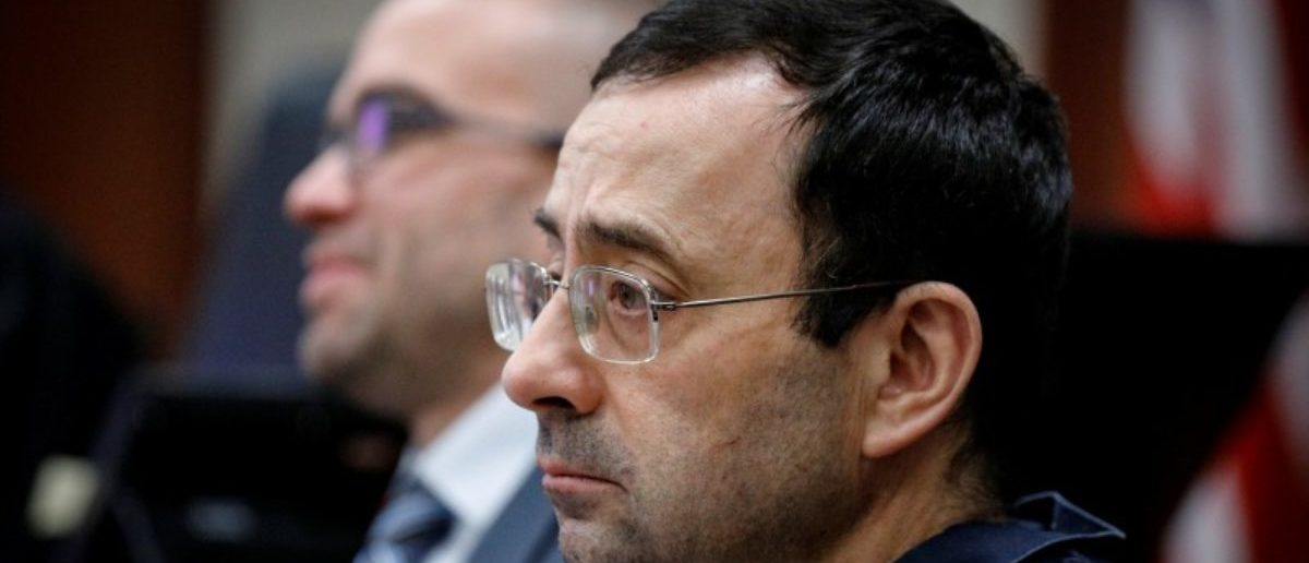 Larry Nassar, a former team USA Gymnastics doctor who pleaded guilty in November 2017 to sexual assault charges, listens to a victim during his sentencing hearing in Lansing, Michigan, U.S., January 16, 2018. REUTERS/Brendan McDermid