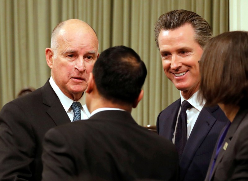 California Governor Jerry Brown and Lieutenant Governor Gavin Newsom greet well wishers after Brown delivered his final state of the state address in Sacramento, California, U.S., January 25, 2018. REUTERS/Fred Greaves