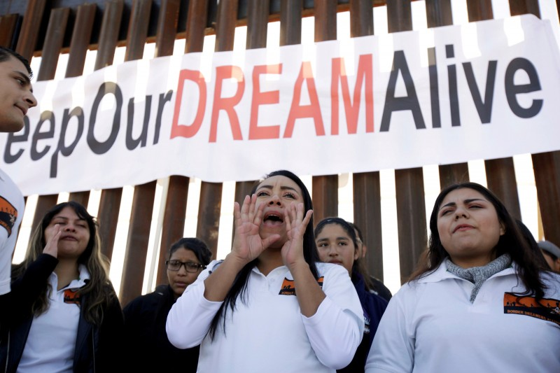 FILE PHOTO: 'Dreamers' react as they meet with relatives during the 'Keep Our Dream Alive' binational meeting at a new section of the border wall on the U.S.-Mexico border in Sunland Park, U.S., December 10, 2017. REUTERS/Jose Luis Gonzalez/File Photo